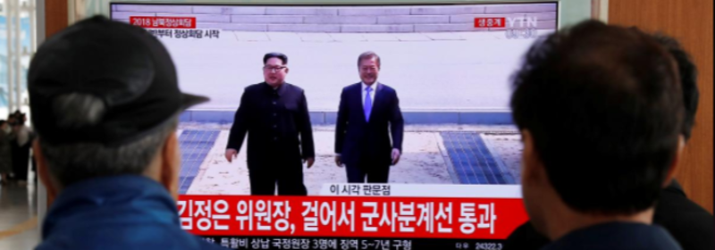 Smiling and holding hands, the leaders of the two Koreas meet at historic summit