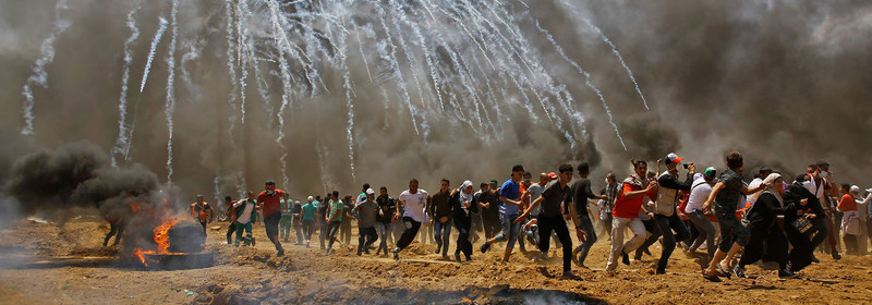 Palestinians bury their dead as Israel is called to account for Gaza violence